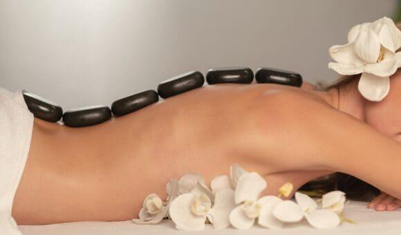 Hot Stone Massage On Woman's Back