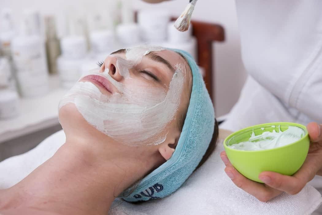 woman having facial spa treatment