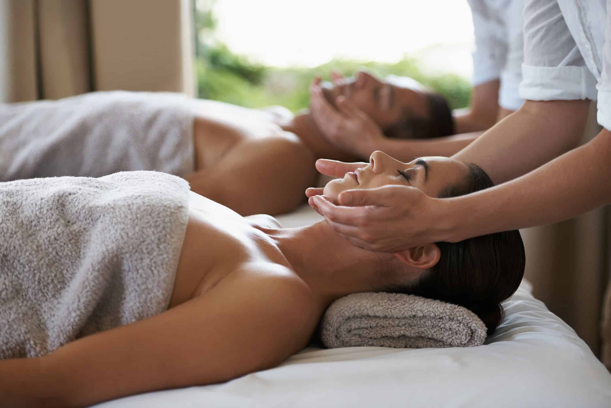 Man and woman on massage bed relaxing with neck massage